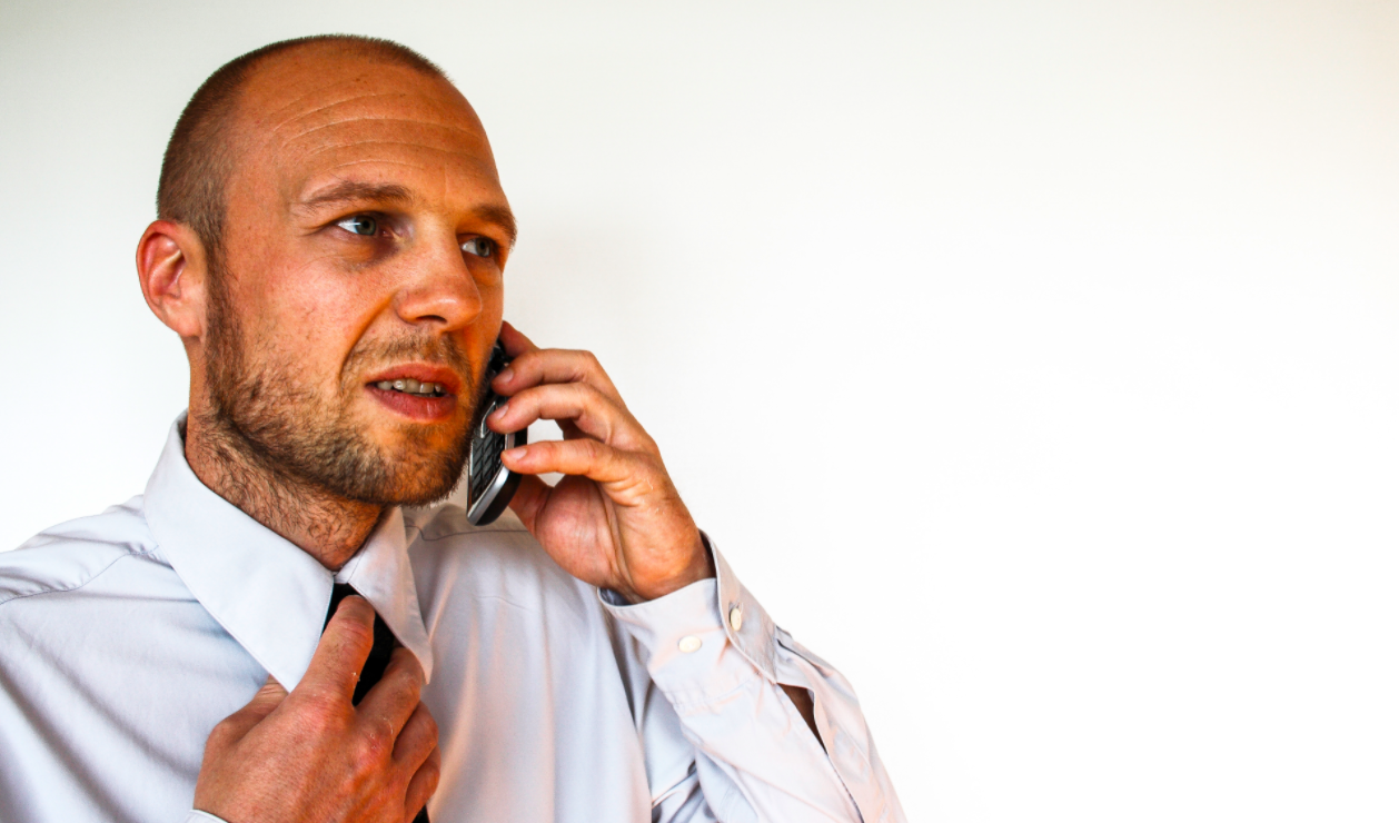 Man on the phone. Learn how to protect yourself from and respond to scams and frauds by visiting USA.gov