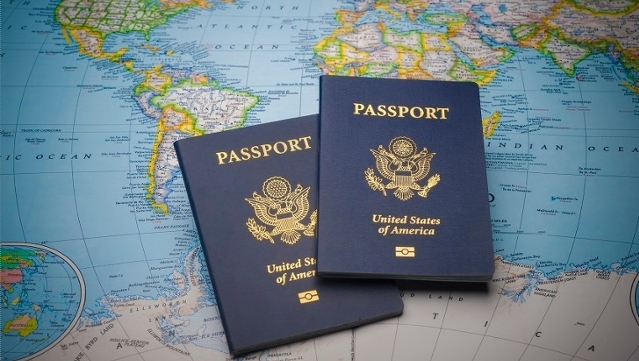 Two passports atop a world map