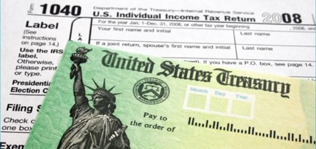 A U.S. Treasury check sits on a tax form.