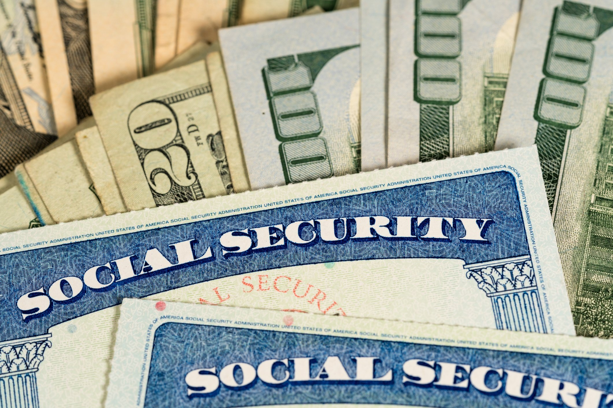 Social Security cards and U.S. dollars
