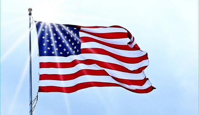 Sun shining over the American flag