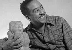 Langston Hughes poses for a photo. Link takes you to africanamericanhistorymonth.gov teachers page.