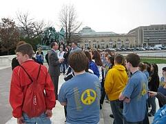 A group of students get a campus tour. Link goes to Student Aid's page on college questions.