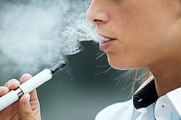 Photo of a child using a e-cigarette. Link takes you to surgeon generals page on e-cigarettes.