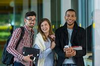 College students pose for a photo. Link goes to DOE's page on college preparation.