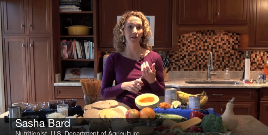 Nutrition Sasha Bard of the USDA poses in her kitchen.