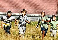 Children run in a field. Link goes to HealthFinder's page on being active.