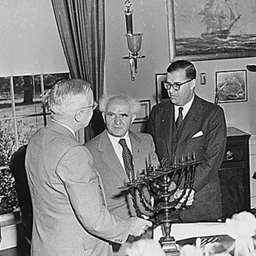 President Truman is presented with a menorah in the Oval Office by Israeli Prime Minister David Ben-Gurlon