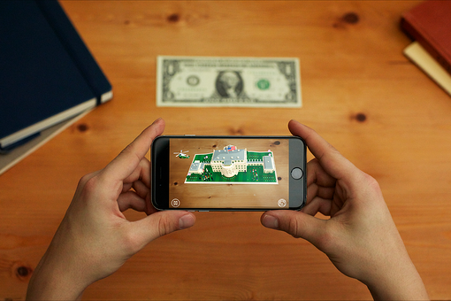 With the 1600 app, you can visit augmented reality with your phone and a dollar bill.