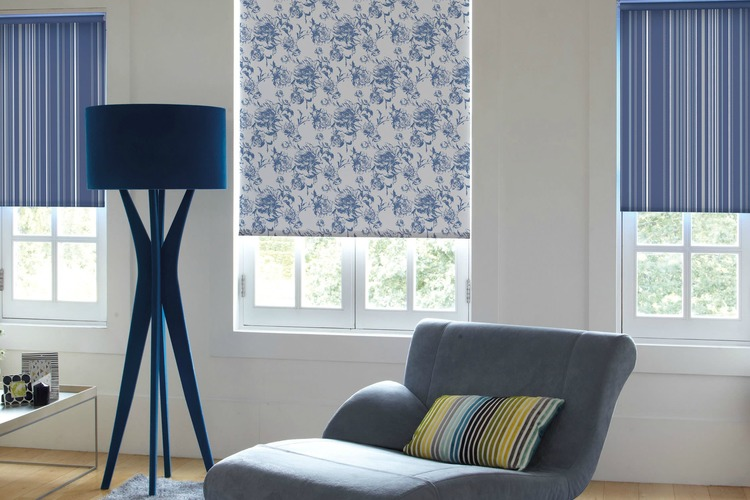blue patterned roller blind in front room half down with light coming through the bottom