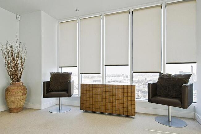cream roller blinds as a dimout in a living room