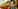 A set of Russian nesting dolls, lined up in a row