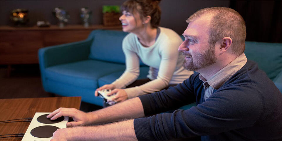 Two gamers playing, one using the Xbox accessible controller