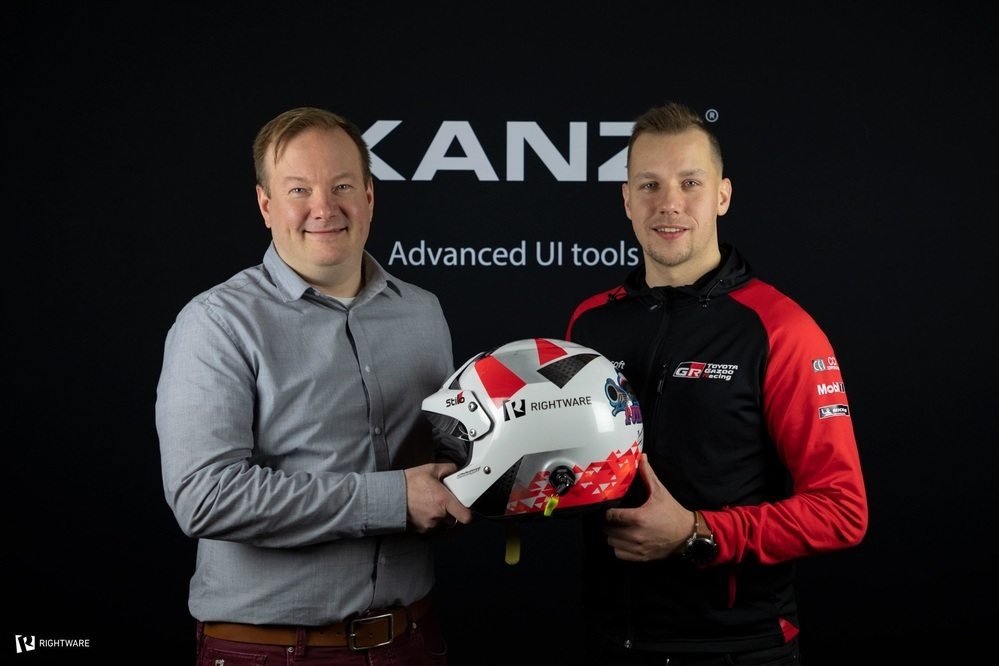 Rightware Sponsors Toyota Gazoo Racing WRC Co-Driver Jonne Halttunen - John and Ville standing together in front of the Kanzi logo.