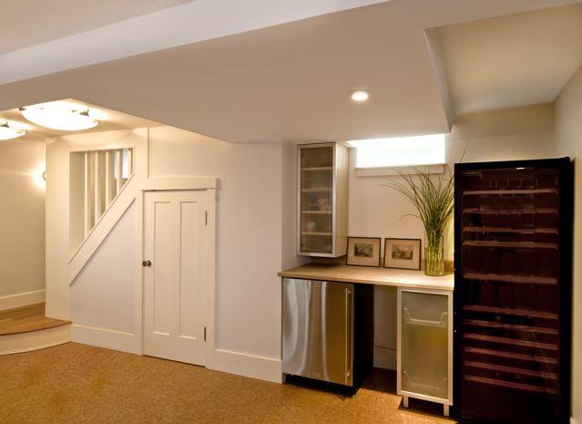 basement renovation transformed what was a typical dark damp basement