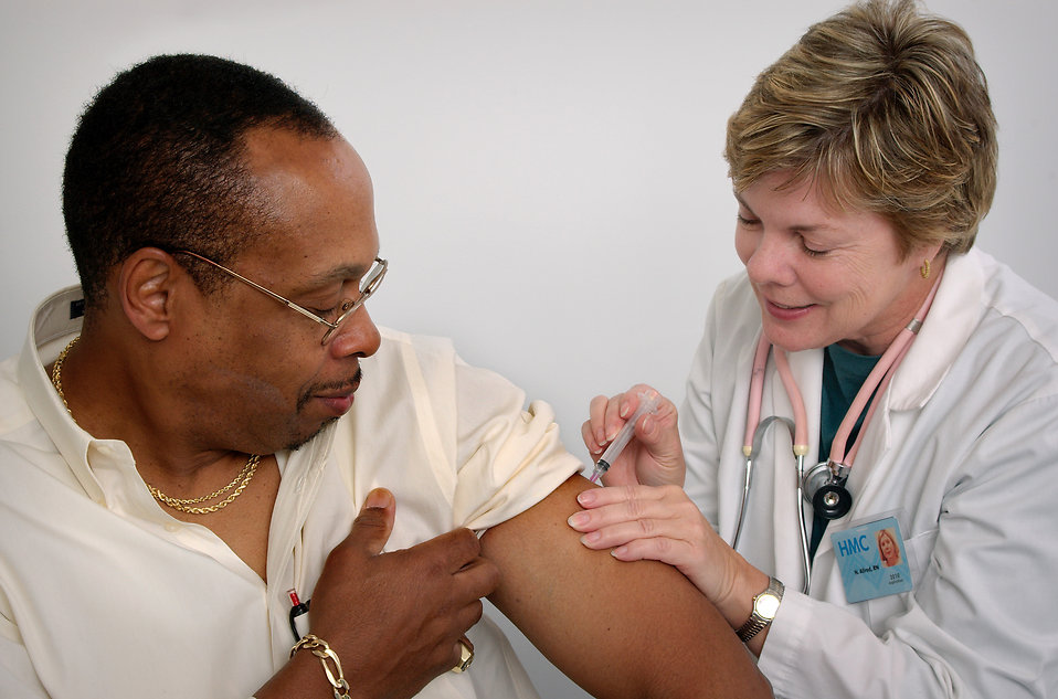 16731-a-nurse-giving-a-middle-aged-man-a-vaccination-shot-pv.jpg