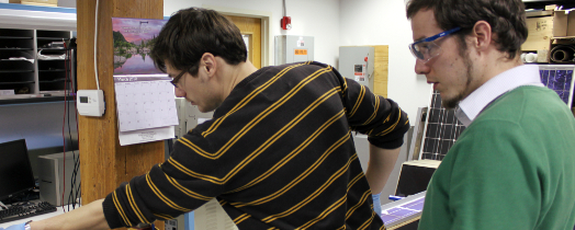 CSE Fellow Matthias Winter examines a solar module in progress.