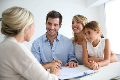 Family meeting with home security professional to install alarm system