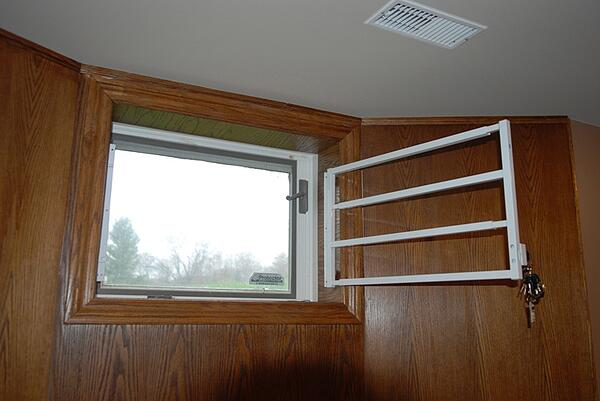 hinged home security bars