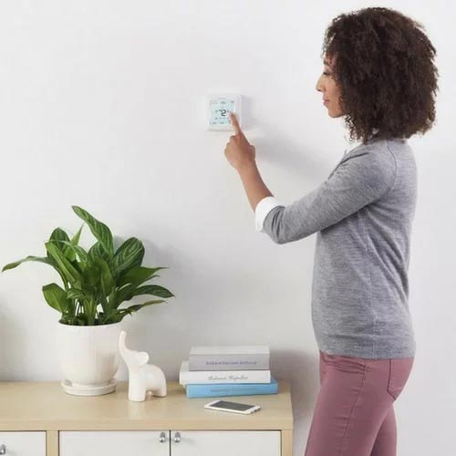 Home automation systems with thermostats