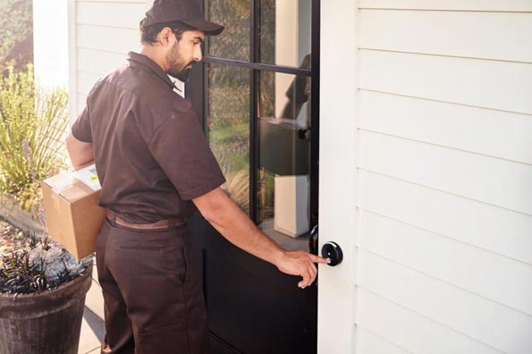 delivery man with package ringing skybell