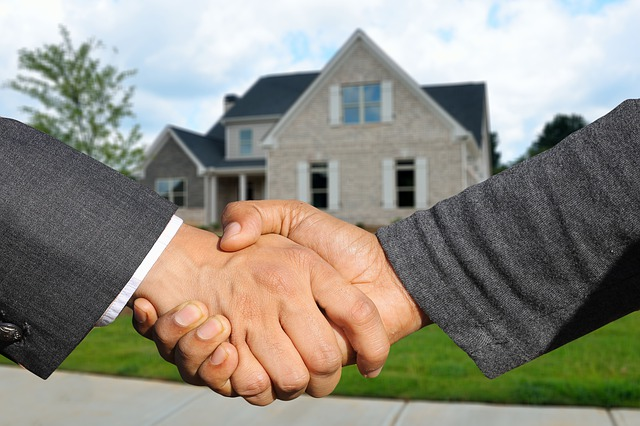 home shaking hands real estate