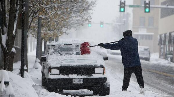snow-storm-car-parked