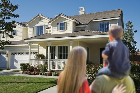 young-family-looking-at-a-new-home-27223539-1