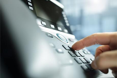dialing-a-telephone-in-the-office-QAGPMHL