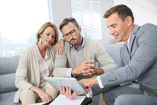 Estate planning attorney with clients