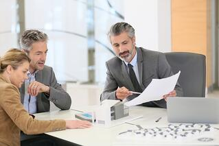 Estate planning attorney reviewing document with client