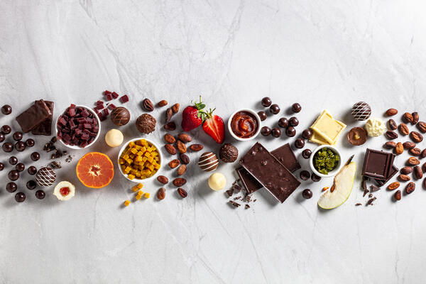 iStock-856324366-beautiful-young-woman-biting-chocolate