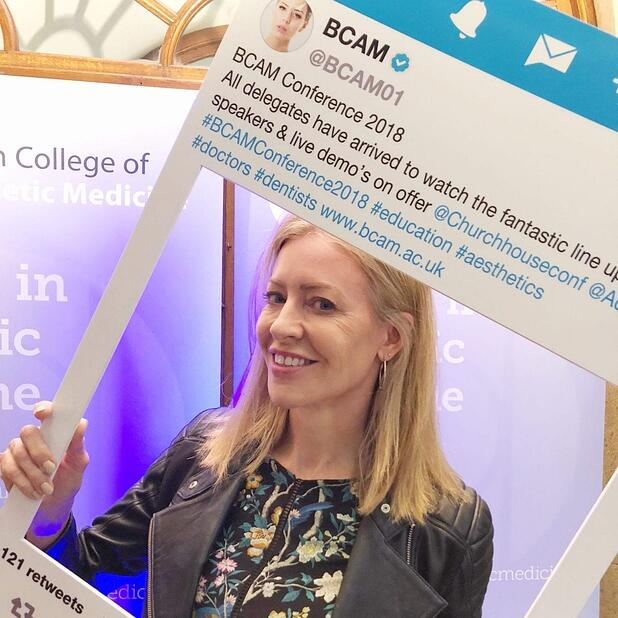 Alice Hart-Davis holding up a social media board at the BCAM conference