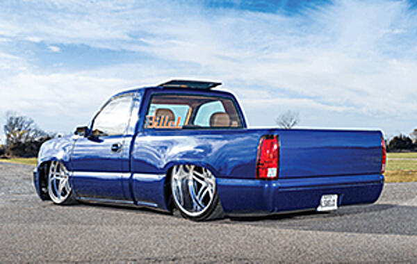 """Named 'En El Suelo' Santiago Torres JR. was 16 years old and working on his first custom truck when he ordered his custom license plate """"NL SUELO"""" which stands for.."""