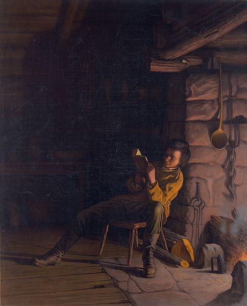 Boy Lincoln reading by firelight resized 600