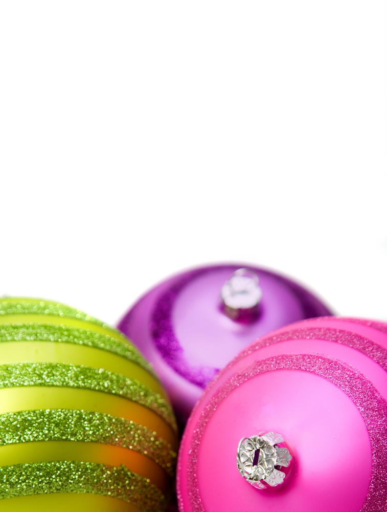 bright colored christmas balls close up on a white background