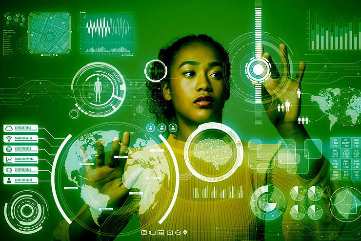 data-scientist_woman-at-virtual-monitor_user-interface_tools-for-data-science-by-metamorworks-getty-100798723-large