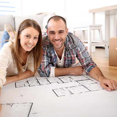 bigstock-Cheerful-couple-looking-at-con-52970389