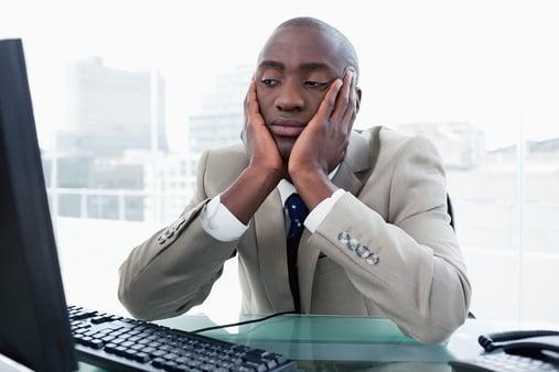 bigstock-Bored-businessman-looking-at-h-28840406