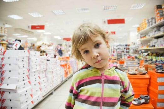 child in department store shutterstock photo