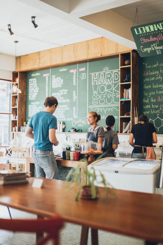 man-standing-near-barista-counter