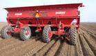 Fully mechanized planters pick up seed tubers