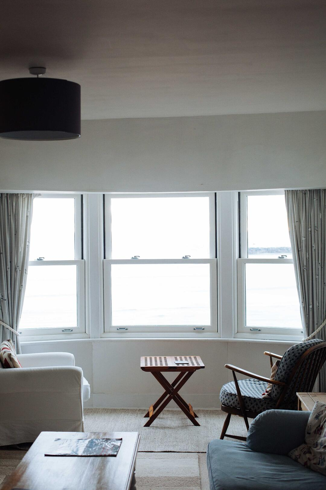 Canva - Two Chairs Facing Towards White Casement Window