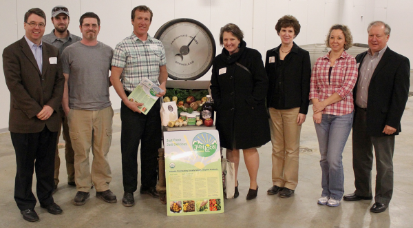 The crew at Just Local Foods pose with USDA officials. From left to right: WI FSA Exec Director Brad Pfaff, Mark Linder, Joshua Staum, Rufus Hauke, USDA Deputy Secretary Kathleen Merrigan, VEDA Exec Dir Sue Noble, Jennifer Rengert, State Director USDA RD Stan Gruszynski