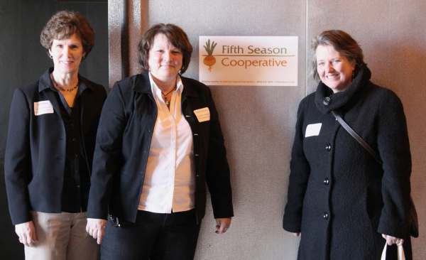 Standing in front of the Fifth Season Cooler in the Food Enterprise Center. From left to right are Susan Noble, Executive Director of the Vernon Economic Development Association, Diane Chapata, Operations Manager of Fifth Season Cooperative and USDA Deputy Secretary Kathleen Merrigan