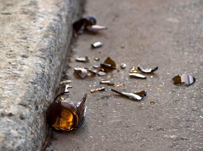 Broken beer bottle in gutter