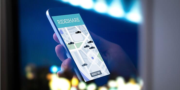 ride-sharing-and-carpool-mobile-application-rideshare-taxi-app-on-picture-id917602244