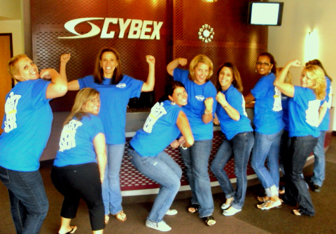 Cybex team posing in strongman poses