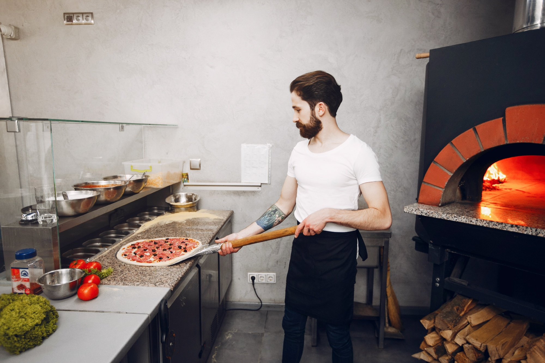 chef-in-the-kitchen-prepares-pizza-9TQJSUH-1