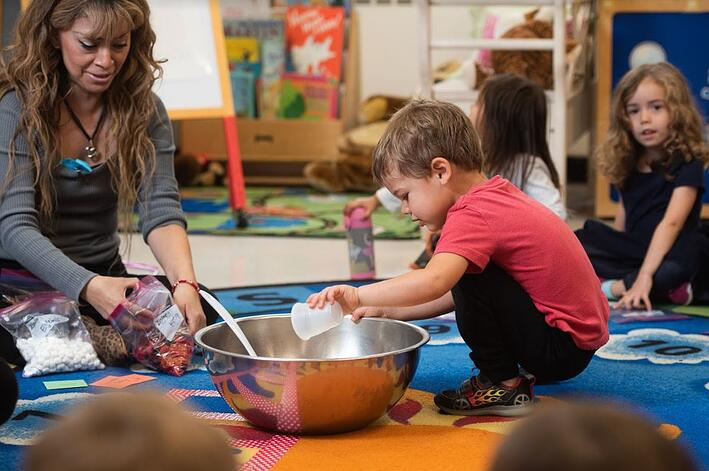 Students learning in preschool